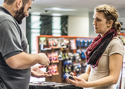 Lady Buying a Gun